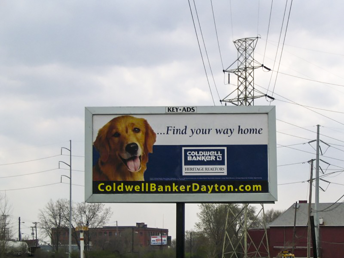 Junior Poster displaying Coldwell Banker Heritage Realtors ad.