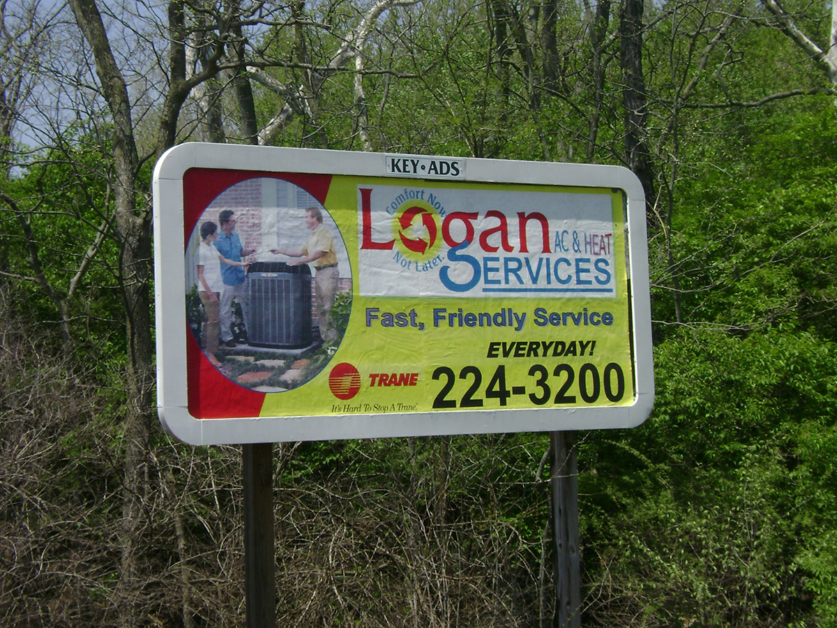 Junior Poster displaying Logan AC & Heat Services ad.