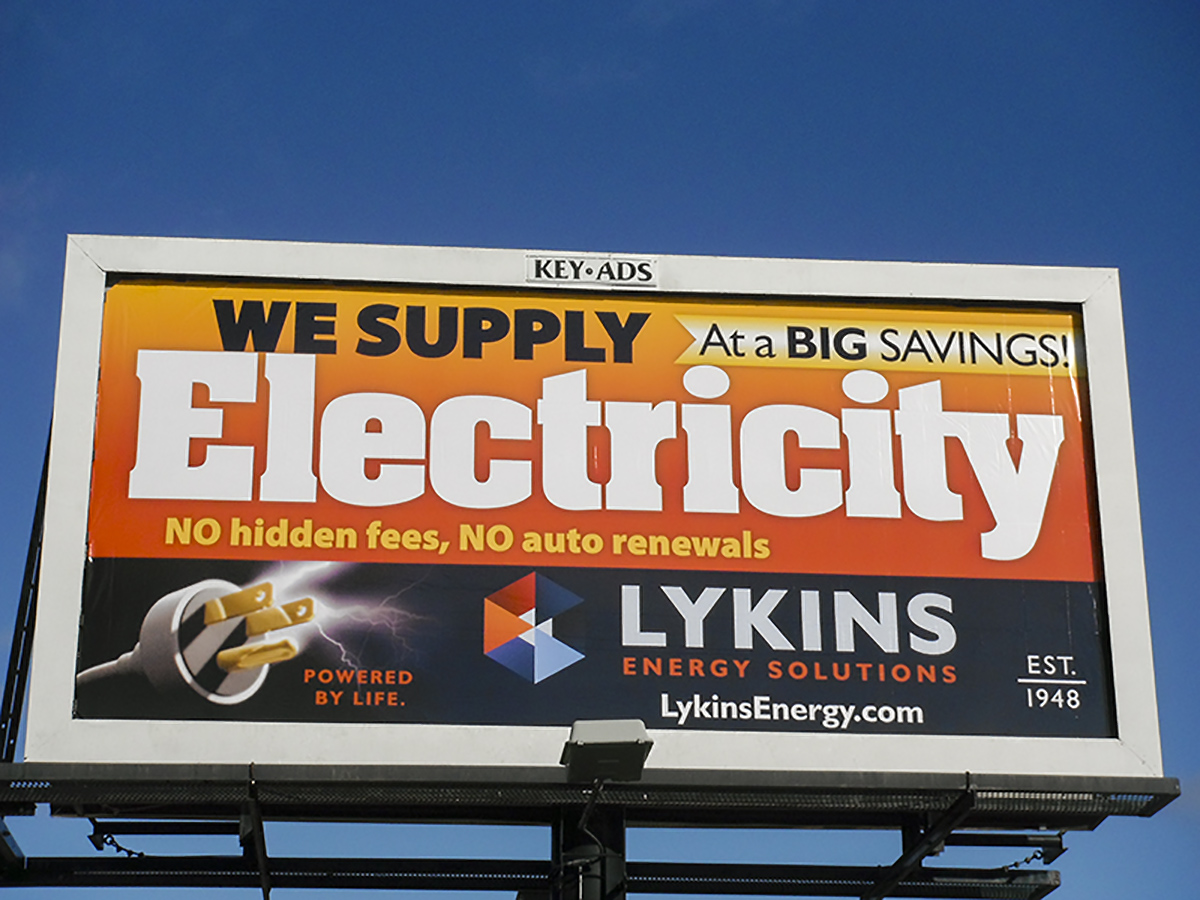30-Sheet Poster displaying Lykins Energy Solutions ad.